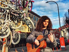 Chord Cycles (Ian Sane) Tags: ian sane images chordcycles man guitar strum chord street musician photography downtown portland oregon zoobomb pile bycycles sunlight phoneography iphoneography iphone 6 six plus