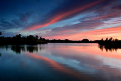 Pink and Blue (NaturalLight) Tags: pink blue sunset water reflections calm kansas wichita cirrus chisholmcreekpark