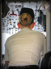 Nice Buns (The Stig 2009) Tags: woman sexy up lady hair high nice cabin long slim legs o sweet aircraft board flight over young cockpit tony clothes crew buns airline captain blonde heels british tt bent tied tight elegant airways stewardess saab attendant 2009 isleofman speaking stig assistant fitting iom shapely on uniformed 2015 touristtrophy thestig tonyo thestig2009