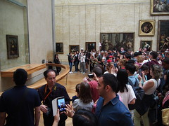 "The hords of tourists infront of Da Vincis ""Mona Lisa""."