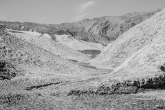 Moony (Raphs) Tags: california blackandwhite usa sun mountains monochrome landscape rocks desert dry shades valley deathvalley moonscape hostile rugged burned clearsky mountainrange raphs deathvalleynationalpark panamintrange aridlandscape tamronspaf1750mmf28xrdiiildaspherical canoneos70d