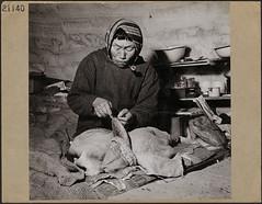 Inuit woman in an igloo making kamiit (sealskin boots), Inukjuak, Quebec / Une femme inuite fabrique des kamiit (bottes en peau de phoque) dans un igloo à Inukjuak, au Québec (BiblioArchives / LibraryArchives) Tags: lac bac libraryandarchivescanada bibliothèqueetarchivescanada canada inuit woman femme women femmes seal phoque identity identité josie boots bottes budglunz january1946 janvier1946 nationalfilmboardofcanada photothèque officenationaldufilmducanada portharrison inukjuak quebec québec igloo kamiit mukluks