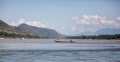 A fisherman at Mekong river in Luang Prabang, Laos (Sitoo) Tags: laos luangprabang asia southeastasia fishing pescando pescador fisherman boat bote barca canoa río mekon montañas mountains nature naturaleza clouds nubes agua water flow corriente