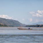 A fisherman at Mekong river in Luang Prabang, Laos thumbnail