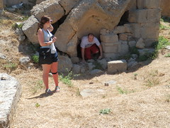 Lizzie watching Patrick emerge from a cave at the Lerna complex