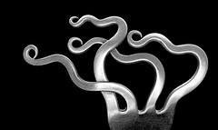 Flying spaghetti monster fork (flowrwolf) Tags: 78prongsfor117in2017 117picturesin2017 117in2017 prongs fork forknapkinring metal blackbackground bentprongs indoor inside black silver macro makro macrophotography canon tokinalens monochrome flowrwolf