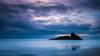 Panatahi Island, Karekare Beach [EXPLORED] (Winston Tan Photography) Tags: longexposure newzealand seascape beach clouds sigma auckland waitakereranges karekarebeach leefilter panatahiisland canoneos70d canon70d leebigstopper sigma1835mmf18