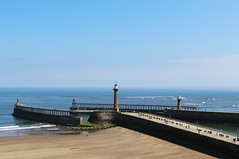 Whitby Harbour (Stevie208) Tags: blue sea sky lighthouse wall coast waves seawall whitby walls yorkshirecoast