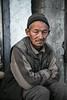 Old man sitting by the corner shop (Redust) Tags: leh ladakh indianmuslims muslimquarter streetscene people faces portrait travel