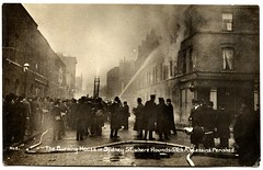 Siege of Sidney Street (1911) (The Wright Archive) Tags: seige siege sidney street battle stepney london vintage postcard valentines 1911 battleofstepney east end gunfight police army latvian immigrants revolutionaries policemen george gardstein rifles guns shot gunfire shootout social history uk twentieth century fire burning building londonfirebrigade hose metropolitanpolice eastlondon wright archive rppc 1900s
