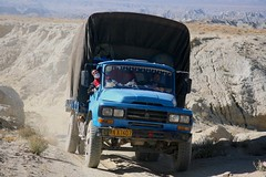 Blue Truck Rugged Dirt Track Badlands Far Western Tibet (eriagn) Tags: truck red blue people asia tiibet farwesttibet cab truckcab decoration tibetanplateau loess rockflower terrain rugged roofoftheworld highaltitude landscape high altitude october autumn cold cliffs semiarid ranges harsh environment fragile expedition tents vehicles greenkiwi camping freezing thinair breathlessness spectacular scenery gravel dust rockdust stream texture tones grass moisture steep campsite ecosystem china tibet farwesterntibet travel eriagn ngairehart ngairelawson photography history sparselypopulated seminomadic 4wd hiking september climate extreme badlands lonelyplanet