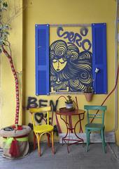 Greek street art (Bianco Rosella) Tags: street blue red woman verde green art window yellow azul bar jaune rouge greek cafe rojo strada arte chairs blu curls vert athens spray finestra greece amarillo giallo grecia rosso sedie atene