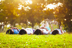 Laying down (Patrick Foto ;)) Tags: park family friends summer people tree cute green nature girl beautiful field grass childhood kids female youth asian fun thailand outside happy four person kid spring funny pretty child natural little outdoor background small joy group young meadow lifestyle happiness sunny down human together thai concept copyspace cheerful laying