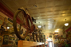 Antique shop, Red Lodge MT (Guilherme Nicholas) Tags: road old trip red signs bike shop sepia nikon montana antique lodge nicholas stuff guilherme beginnerdigitalphotographychallengewinner