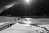 Lago gelato (Vanda Guazzora) Tags: sole lago montagna ghiaccio pontile lagodipontechianale valvaraita biancoenero