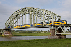 Crossing the bridge (PJ Reading) Tags: old bridge holland heritage netherlands dutch electric train ns arnhem nederland rail railway double deck commuter emu pax passenger nl regional spoor intercity spoorwegen virm