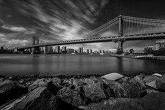 Manhattan Bridge, New York City (Davoud D.) Tags: nyc newyorkcity longexposure bridge newyork brooklyn manhattan dumbo le manhattanbridge eastriver lowermanhattan newyorkbridge
