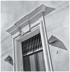Puerta y Lamparas (Door & Lamps) (Black and White Fine Art) Tags: argus argusargoflexseventyfive1950 arguslumar75mm sombras shadows lamparas lamps door puerta sanjuan oldsanjuan viejosanjuan puertorico lightroom aviary niksilverefexpro2