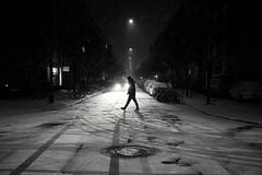 Crossing (maekke) Tags: zürich wiedikon kreis3 idaplatz snow night availablelight humanelement man streetphotography fujifilm x100t 2017 bw noiretblanc