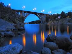 Going Away (Jens Haggren) Tags: longexposure bridge water reflections lights rocks sweden olympus explore omd em1 nacka skurubron