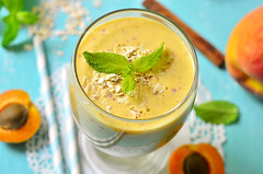 Peach and apricot smoothie. (lilechka75) Tags: morning summer food cold glass closeup fruit breakfast recipe table dessert wooden milk healthy mixed drink sweet cinnamon background cereal smooth cream peach mint banana fresh gourmet oatmeal delicious cocktail homemade honey snack blended shake apricot diet yogurt milkshake granola smoothie oats lassi freshness puree creamy whipped refreshment dieting muesli