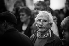 A face in the crowd (Frank Fullard) Tags: frankfullard fullard candid street portrait face crowd ballinasloe horse fair horsefair mono blackandwhite noir anxious watching irish ireland galway