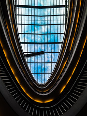 orange.blue.stilwerk (grizzleur) Tags: city blue sky urban orange lines architecture clouds geometry curves fluorescent olympusm17mmf18 olympusomdem5mkii