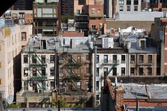 Escapes (jevidal) Tags: man rooftop buildings chinatown peeing urinate graffiti