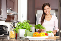Woman cooking in new kitchen (tigercop2k3) Tags: new portrait people food woman house canada home cooking kitchen girl beautiful vegetables smiling modern dinner work asian happy person salad healthy women eating interior chinese cook lifestyle vegetable fresh eat domestic health homemade meal greens vegetarian wife diet multicultural ethnic housewife making salads preparing 20s nutrition multiracial mixedrace newkitchen lookingatcamera
