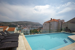 Dubrovnik 2 (Jori Samonen) Tags: sea sky mountain cars water pool clouds buildings landscape view chairs croatia dubrovnik babinkuk