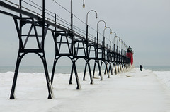 Winter Walk on the Pier (Tom Gill.) Tags: lighthouse pier catwalk ice winter frozen lake lakemichigan greatlakes southhaven lighthousetrek