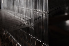 Weaving (wagnerchristian.com) Tags: weaving machine cloth detail strings light lines structure stiches fabric texture factory manufacturing