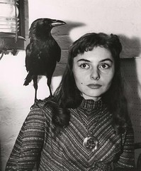Beatnik Chick with Raven (kevin63) Tags: lightner photo woman young longhaired raven shoulder beatnik pretty 50s 60s girl chick beatgeneration medallion sweater