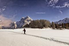 Hiking through the snow (Manuel Beusch) Tags: arnisee winter snow windgällen lake hiking swissmountains mountain