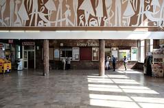 Koszalin railway station (awbaganz) Tags: koszalin pkp railwaystation hall mural tiles pillars people travel architecture interior inside building design fuji xe1 xf1855 poland ticketoffice kasy bilety kantor