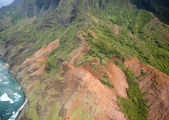 The Kalalau Trail crosses from left to right. Then in middle of photo the trail drops to the bottom of the Red Hill. It may look steep from this angle but it isn't.  Kalalau Trail Aerial. Na Pali Coast, Kauai, Hawaii (lihue1946) Tags: hiking kauai hawaii trail cliffs cliff aerialkalalautrail red hill napalicoast