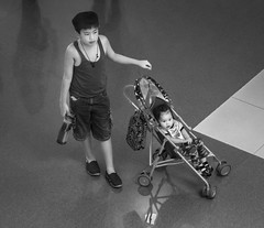 Brother and Sister (FotoGrazio) Tags: family people blackandwhite baby art kids composition contrast children asian photography toddler infant photoshoot sister stroller brother philippines siblings manila filipino moment photographicart babysitting capture brotherandsister pasay socialdocumentary digitalphotography babystroller pacificislanders documentaryphotography mallofasia sandiegophotographer artofphotography californiaphotographer internationalphotographers worldphotographer photographersinsandiego fotograzio photographersincalifornia waynegrazio waynesgrazio