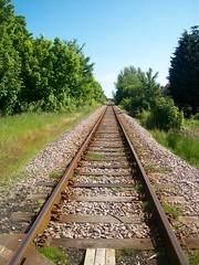 Straight as an arrow! (Martha-Ann48) Tags: trees urban green lines metal rust crossing transport railway stretch straight distance bushes gravel sleepers