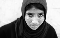 A syrian woman refugees in Mersin (adnansharbaji) Tags: street light italy woman face children deutschland 50mm lights book eyes nikon war italia refugees border syria trieste udine kilis d700