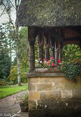 Batsford Arboretum (judy dean) Tags: judydean 2016 sonya6000 batsford arboretum autumn stone thatch geraniums verandah