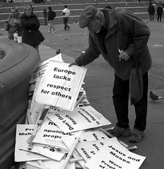 Political Conspiracies (Zulpha) Tags: old uk winter portrait england people bw woman white man black cold bird london art look birds animal sign mystery lady digital photoshop canon square beard lost outdoors nose one movement others war europe alone different looking cheek arms arm respect britain pigeon muslim islam politics jesus crowd protest overcast naturallight down 2006 ps right moses messy stalker stare aged curious unusual awake february contemplative deepinthought cartoons surrounded angst slander unaware canond30 discover misplaced manipulate canoneosd30 lacks 79points mireasrealm interestingness185 i500 prophetmohammedsaw explore21feb06 zulpha lostandalone
