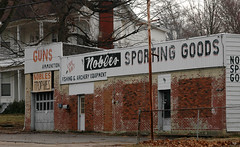 Noble's Sporting Goods (Jim Frazier) Tags: old travel signs travelling abandoned sign shop retail rural advertising town store fishing scenery commerce cityscape decay kentucky bricks country roadtrip baitshop 2006 business faded forgotten commercial storefront shops guns storefronts february henderson stores sales advertisements merchants trade selling bait smalltown carwindow mercantile retailer q2 baitsign seminartrip ohiomississippiriverstrip omrt jimfraziercom