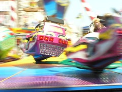 Colors of the fair (Frankss) Tags: motion blur colors girl speed wow geotagged interestingness movement colours action mother fair dizzy panning funfair flickrexplore