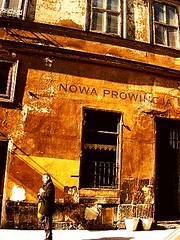 now sunshine - (jadziajadzia) Tags: old windows orange building topf25 yellow spring warm bright rusty poland cracow plato caffe sunnyday stanger nowaprowincja therepublic allegoryofthecave brackastreet facetowardsthesun themomentofhesitation newprovince