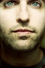 pierce (seventytw0dpi) Tags: man face closeup eyes yuval stubble gloomyheart colorphotoaward