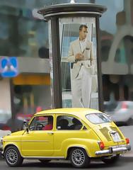 Advertising is big business (Micheo) Tags: cars smile yellow ads advertising model publicidad modelo business amarillo sonrisa coches adverts anuncios contrastes seiscientos seat600 paradoja