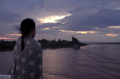the punishment of loneliness (Zenith Phuong) Tags: sunset selfportrait topf25 tag3 taggedout river tag2 tag1 vietnam mekong mireasrealm zenithphuong