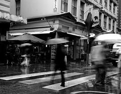 flinders lane occasional showers (ziz) Tags: blackandwhite rain crossing australia melbourne victoria degravesstreet flinderslane centreplace skybus thequarter