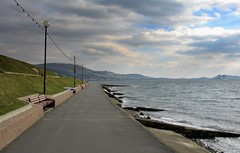 Quiet Seafront (Scott Foy) Tags: sea sky water clouds canon coast scotland clyde waves hills seafront benches firth ayrshire largs lampposts a620 firthofclyde scottfoy