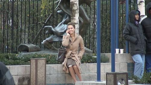 Jessica Alba on phone, on the set